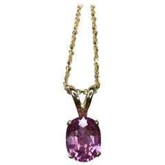 Untreated Vivid Pink Sapphire 1.00 Carat Solitaire Oval Cut Yellow Gold Pendant