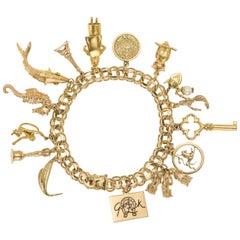 Vintage 14 Karat Yellow Gold 15 Charms, Charm Bracelet