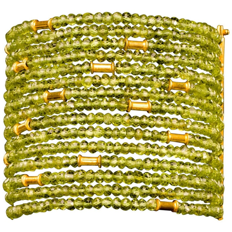 Dancing Apsara Peridot and Gold Cuff Bead Bracelet