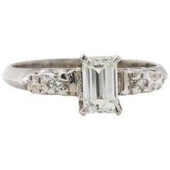 Vintage Engagement Ring Platinum 0.63 Carat Emerald Cut G-VS1, circa 1950s