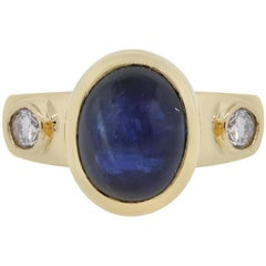 Oval Cabochon Sapphire and Diamond Ring