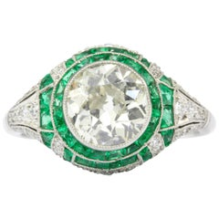 Art Deco Platinum 1.66 Carat Diamond and Emerald Ring