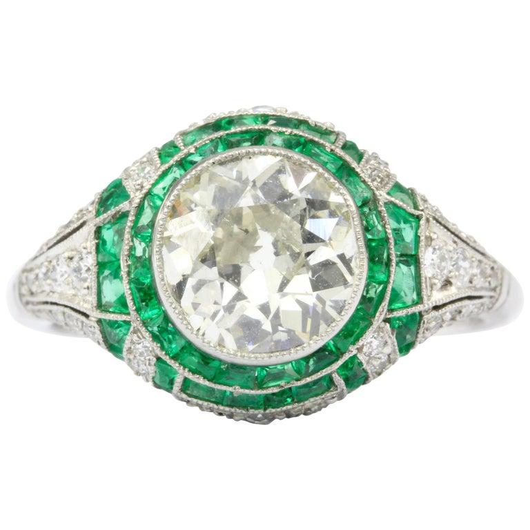 Art Deco Platinum 1.66 Carat Diamond and Emerald Ring