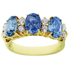 Yellow Gold Trinity with Oval Cut Sapphire and Brilliant Cut Diamonds Ring
