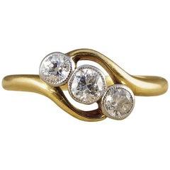 Antique Edwardian Diamond Three-Stone Twist 18 Carat Gold and Platinum Ring