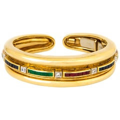 Diamond, Emerald, Ruby, Sapphire and 18 Karat Gold Bracelet by Andrew Clunn