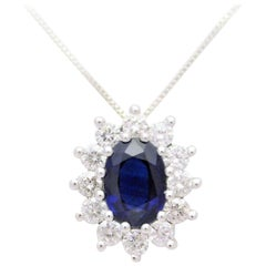 14 Karat White Gold Natural Deep Blue Sapphire and Diamond Halo Pendant Necklace