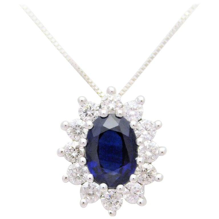 14 Karat White Gold Natural Deep Blue Sapphire and Diamond Halo Pendant Necklace