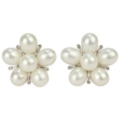 14 Karat White Gold, Diamond and Pearl Cluster Floriform Clip Earrings