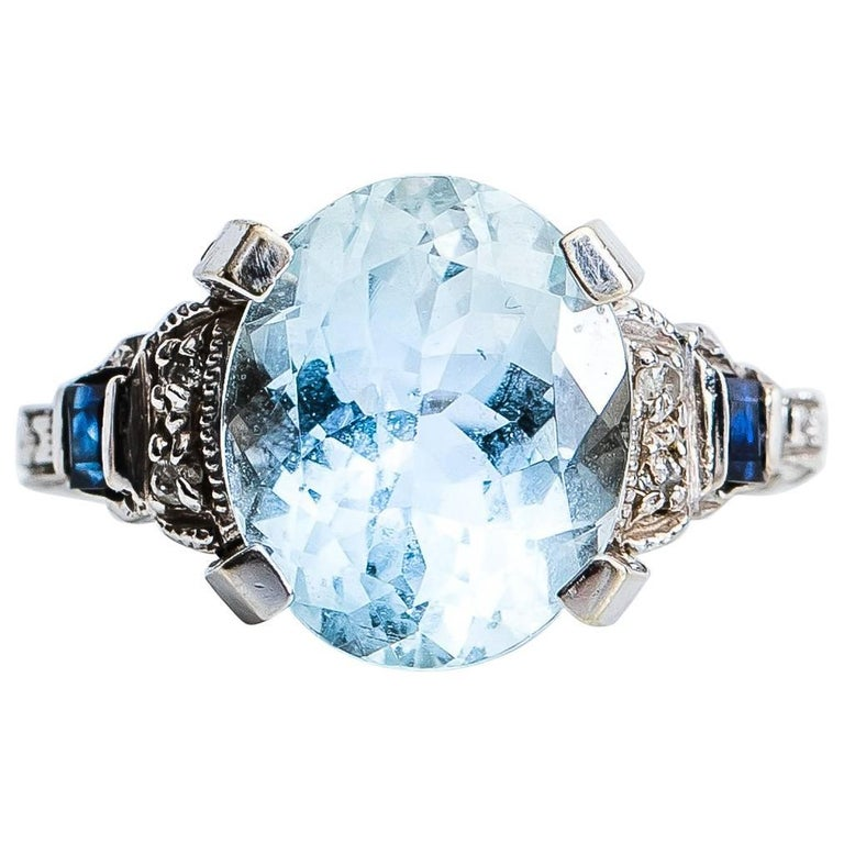 1950s 3 Carat Oval Aquamarine, Diamond and Sapphire 14 Karat Gold Ring
