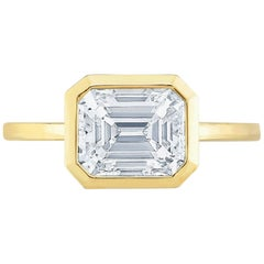 East West Emerald Cut Diamond in Yellow Gold
