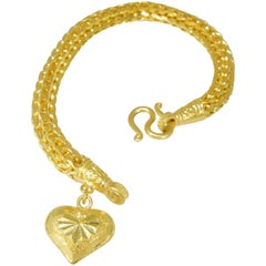 Gold Braided Bracelet with Heart Shaped Charm