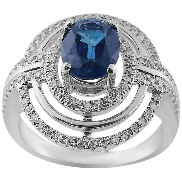 White Gold Oval with Oval Cut Sapphire and Brilliant Cut Diamonds Ring For Sale