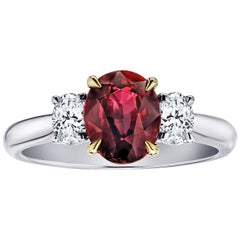 1.89 Carat Oval Red Spinel and Diamond Three-Stone Platinum Ring