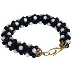 Onyx and White Coral 14 Karat Yellow Gold Clasp Rope Bracelet by Marina J