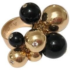 18 Karat Yellow Gold and Onyx Tassel Ring with Diamonds