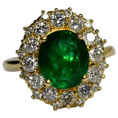 Oval Emerald Diamond Gold Engagement Ring
