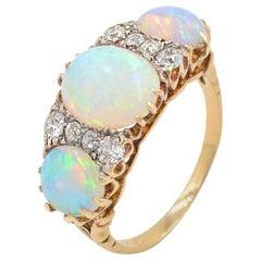 Victorian Three-Stone Opal and Diamond 14 Karat Yellow Gold Ring, circa 1900