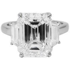 GIA Certified 4.77 Carat Emerald Cut Platinum Three-Stone Ring