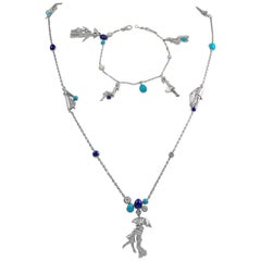 Van Cleef & Arpels Diamond, Gem-Set Necklace and Bracelet