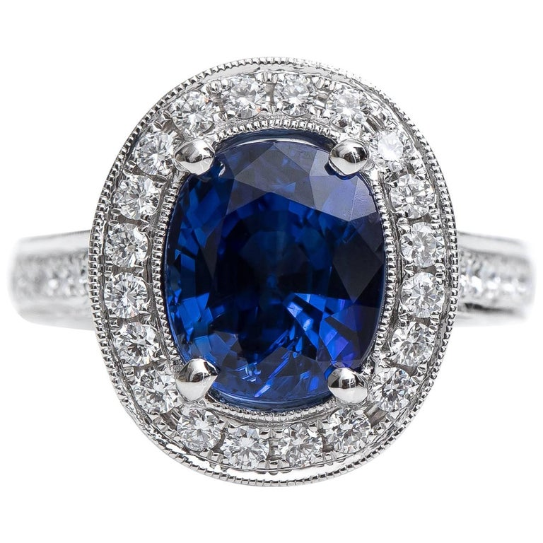 GIA Certified 3.75 Carat Cushion Oval Sapphire and Diamond Halo Ring