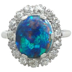 1930s Black Opal and Diamond Platinum Cluster Ring