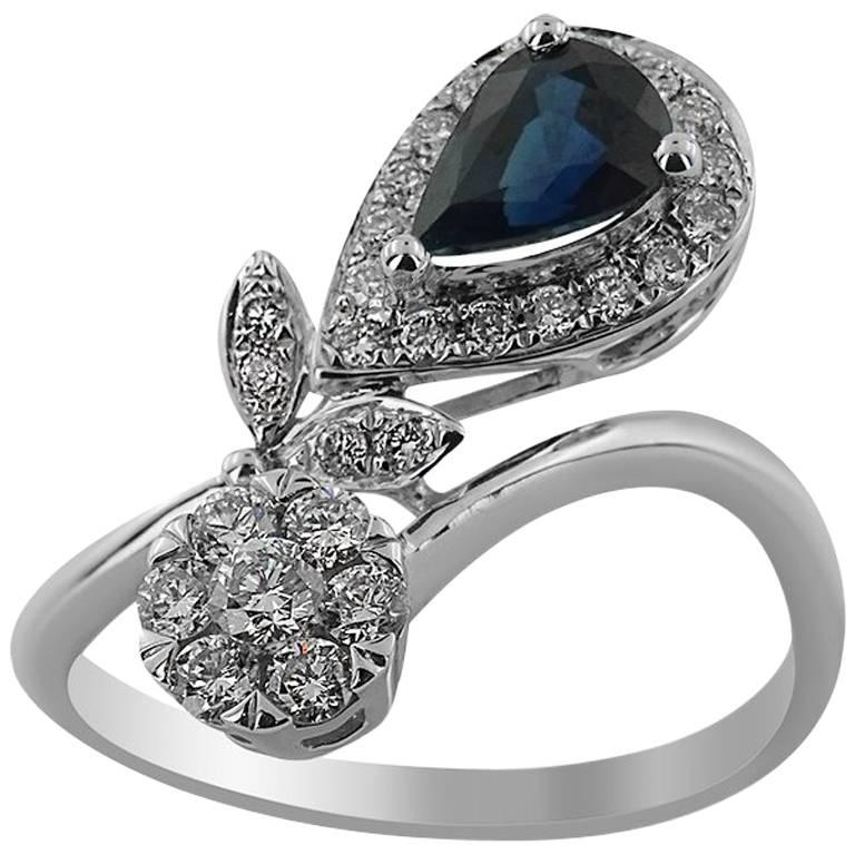 White Gold with Pear Shaped Sapphire and Brilliant Cut Diamonds Ring For Sale