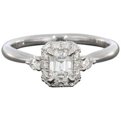 14 Karat White Gold Emerald Halo Diamond Engagement Ring