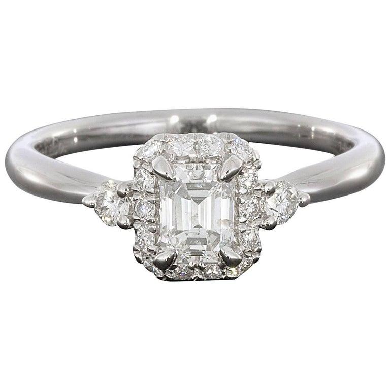 14 Karat White Gold Emerald Halo Diamond Engagement Ring
