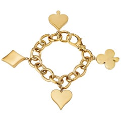 Aldo Cipullo for Cartier Four Suits 1970s Gold Charm Bracelet
