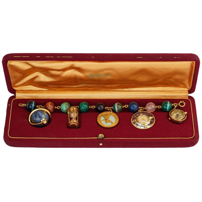 Gubelin Time Themed Gold and Hard Stone Charm Bracelet Watch For Sale