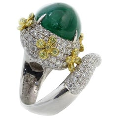 Splendid White Gold, Diamonds, Emerald and Sapphires Ring