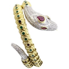 Diamonds Sapphires Emerald Rubies Yellow and White Gold Snake Bracelet