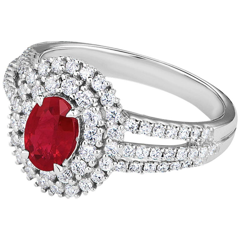 0.78 Carat Oval Ruby and Diamond 18K White Gold Ring