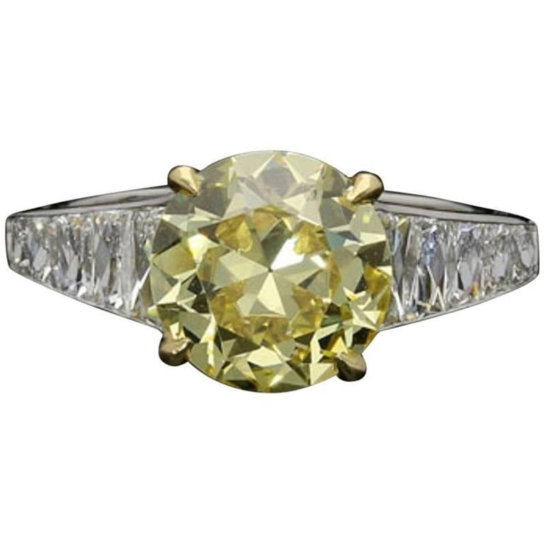 2.41 Carat Fancy Intense Yellow Diamond Ring with Tapering French-Cut Diamond For Sale