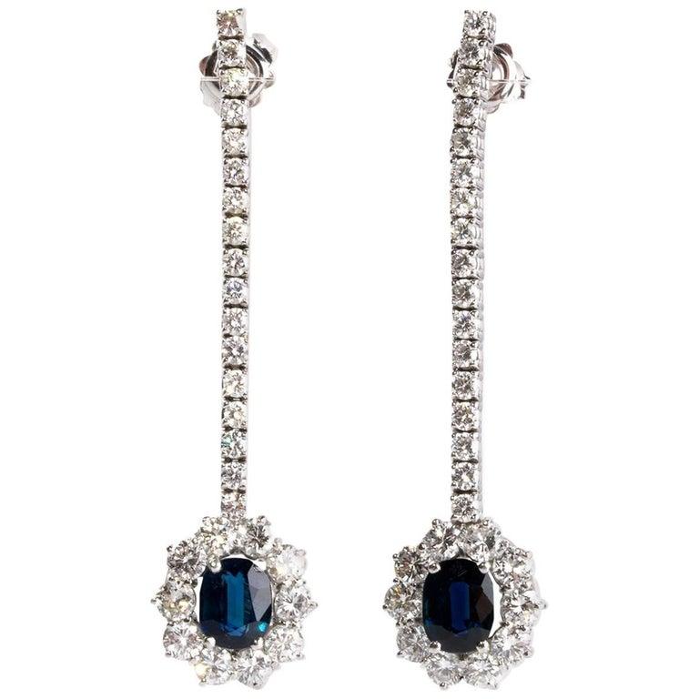 Pair of Blue Sapphire Diamond Halo Gold Earrings