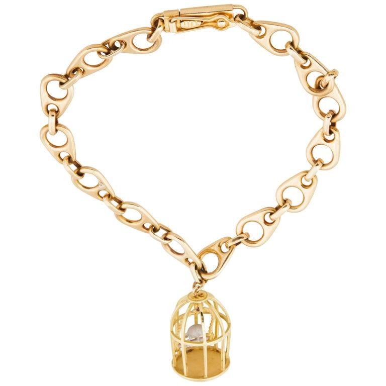 1960s French 18 Karat Gold Link Bracelet with Vintage Gold Birdcage Charm
