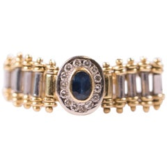 1980s Oval Sapphire and Diamond Halo 18 Karat Gold Flex Ring