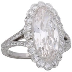 3.35 Carat Moval Diamond Ring with Scalloped Halo Surround and Split Shoulders