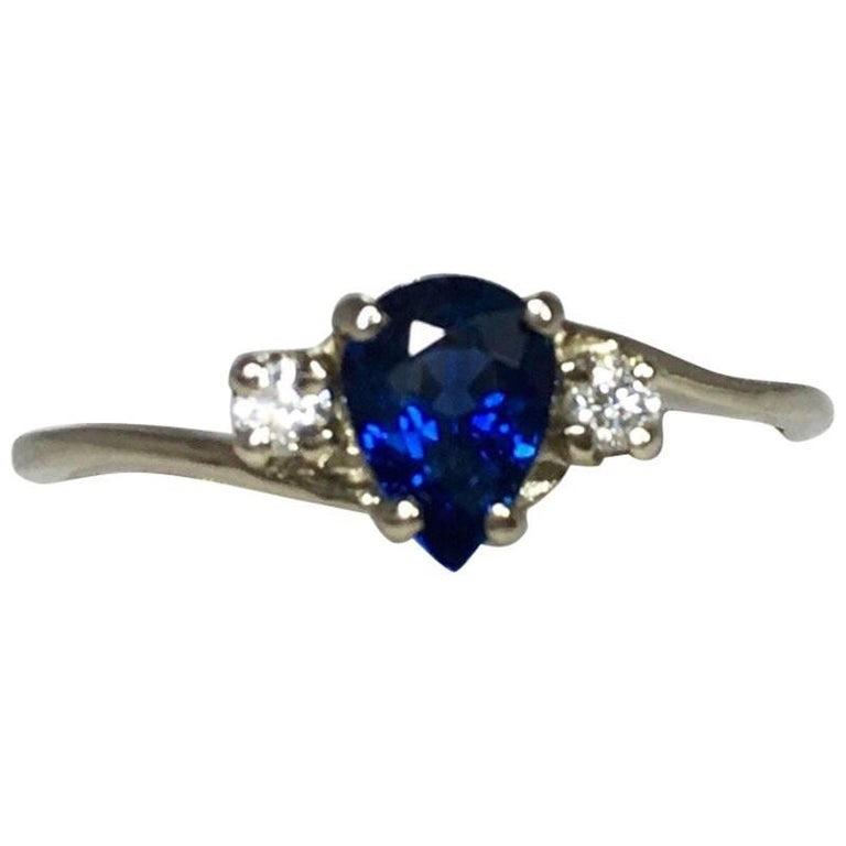 IGI Certified Untreated Ceylon Blue Sapphire and Diamond Three-Stone Gold Ring