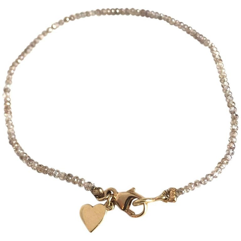 Julius Cohen Gold Heart Charm and Natural Color Diamond Bead Bracelet
