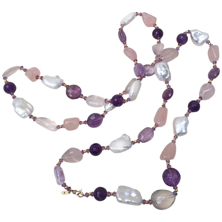The rose quartz, amethyst, pearl, and vermeil gold beads give this necklace with tassel great contrasting light and dark tones. The contrasting tone is highlighted by the different shapes and textures of the beads. A 14k yellow gold clasp secures