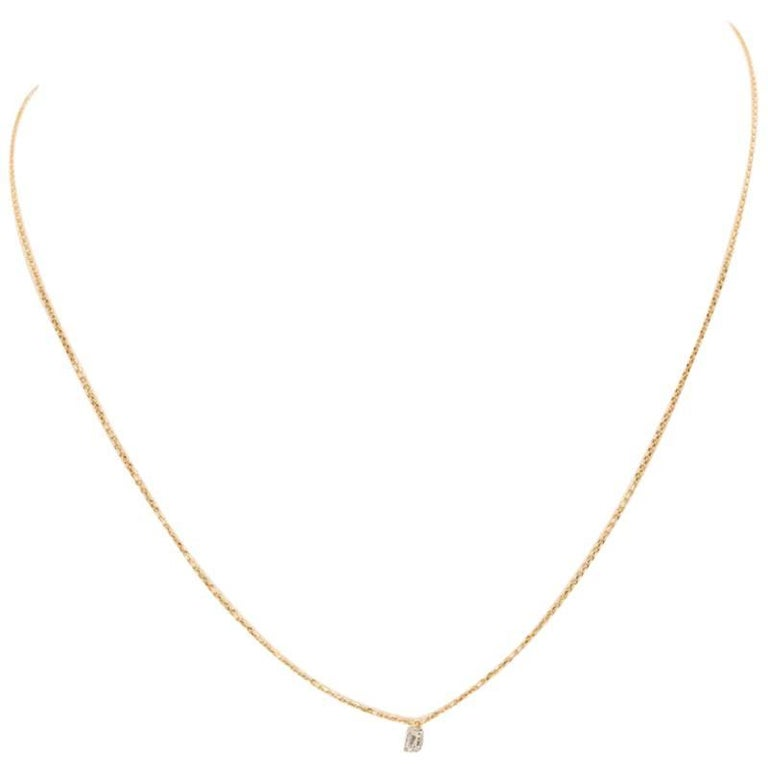 18 Karat Yellow Gold and Baguette Cut Diamond Necklace