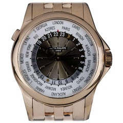 Patek Philippe Rose Gold World Time Sunburst Dial Automatic Wristwatch