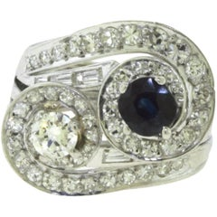 Diamond and Sapphire Center Stone Diamond White Gold Swirl Ring