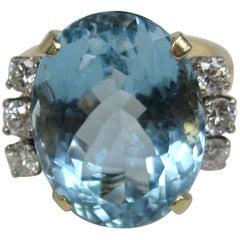 Ladies GIA Certified 13.13 Carat Oval Aquamarine Diamond 14 Karat Gold Ring