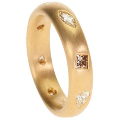 22 Karat Gold Band Featuring Eight White and Fancy Color Diamonds