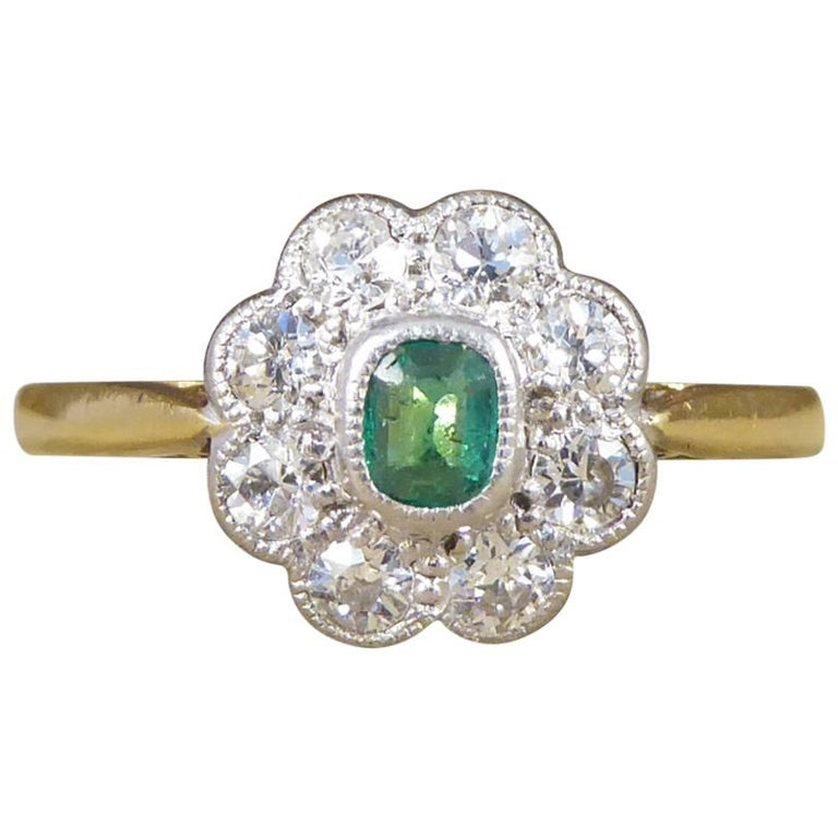 Emerald and Diamond Cluster Ring in Platinum and 18 Carat Gold, circa 1930s