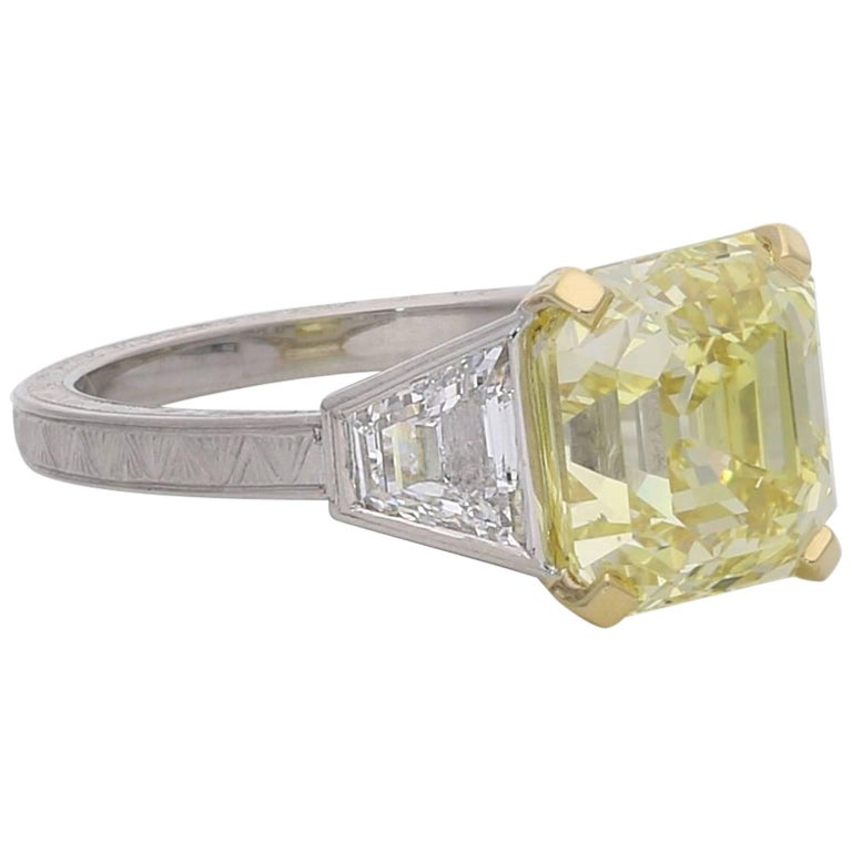 4.97 Carat Fancy Intense Yellow Assher-Cut Diamond Ring with Trapezoid Shoulder