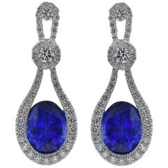 Diamond and Blue Sapphire Dangle Earrings in White Gold